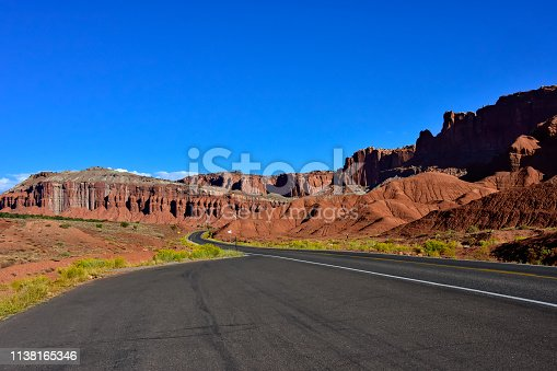 Lonely road going through Capitol Reef National Park, Utah.