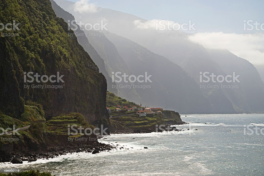 Road through cliffs on the north coast of Madeira stock photo