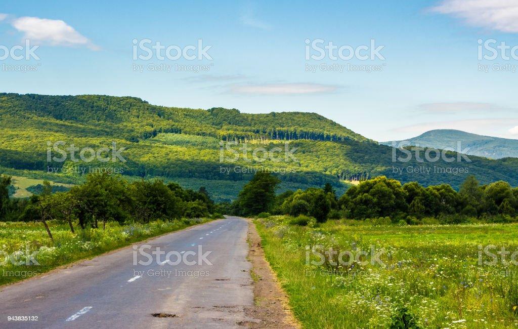 road through mountainous countryside stock photo