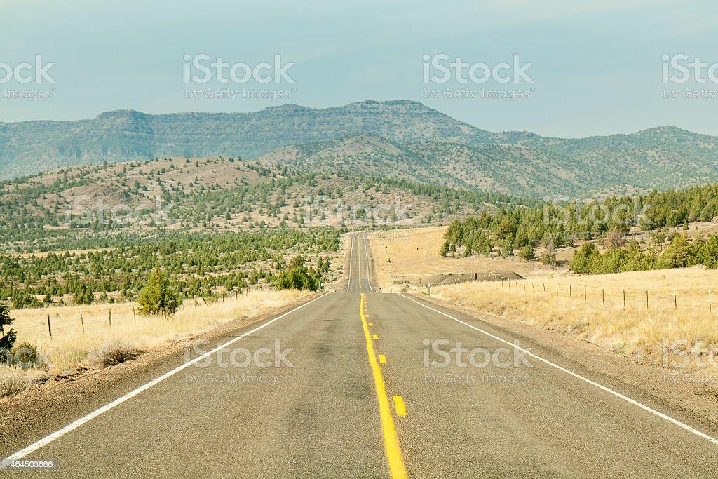 Road through prairie stock photo