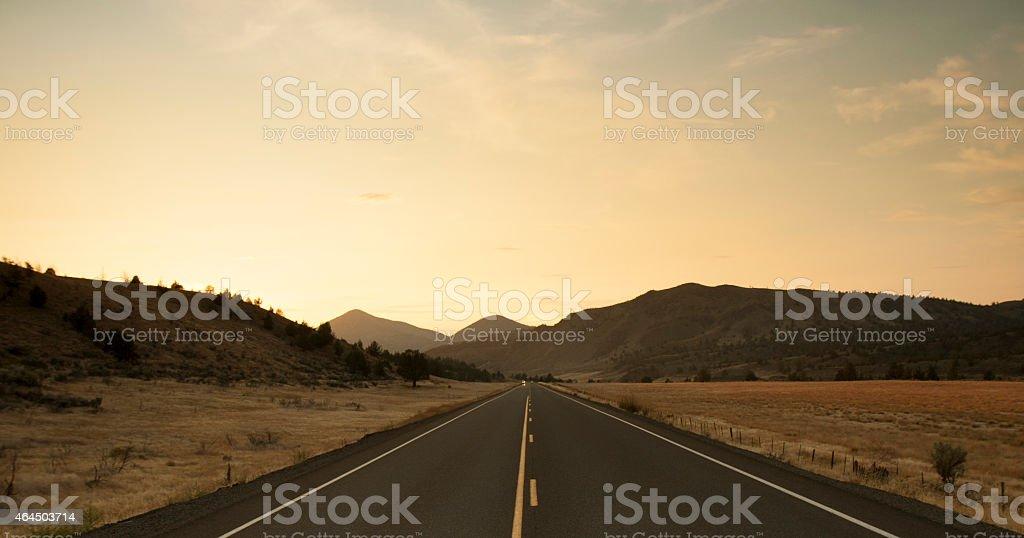 Road through prairie3 stock photo