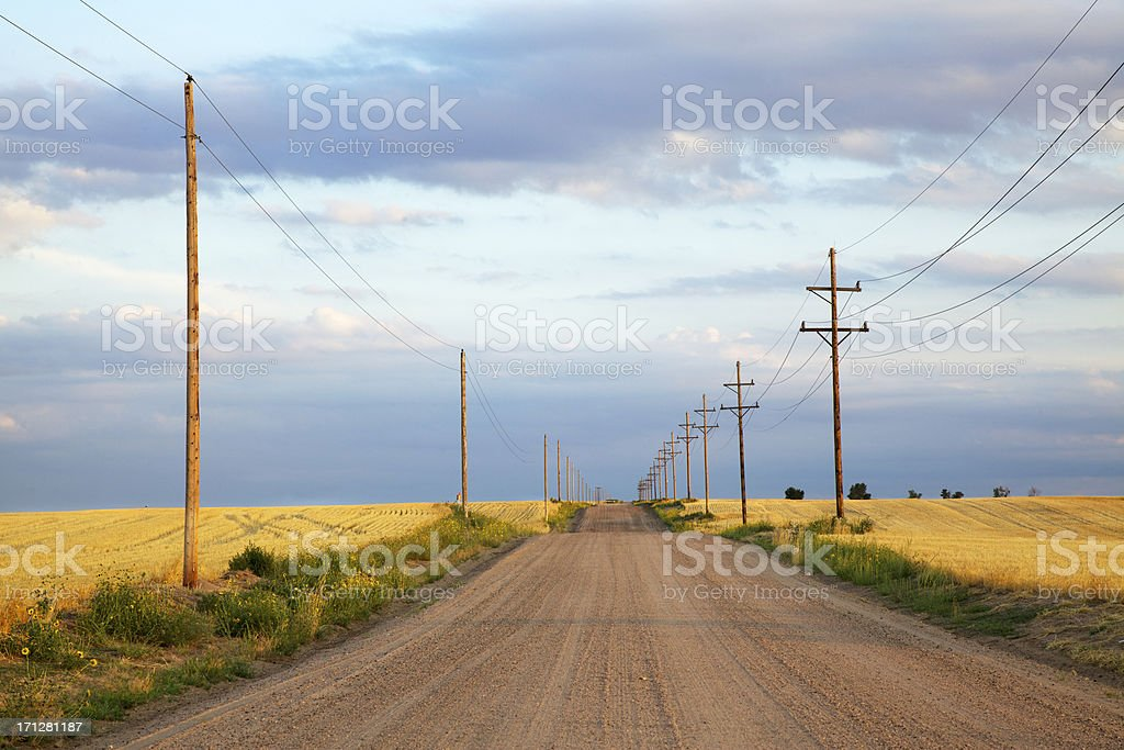 Road Through Rolling Hills and Prairie stock photo