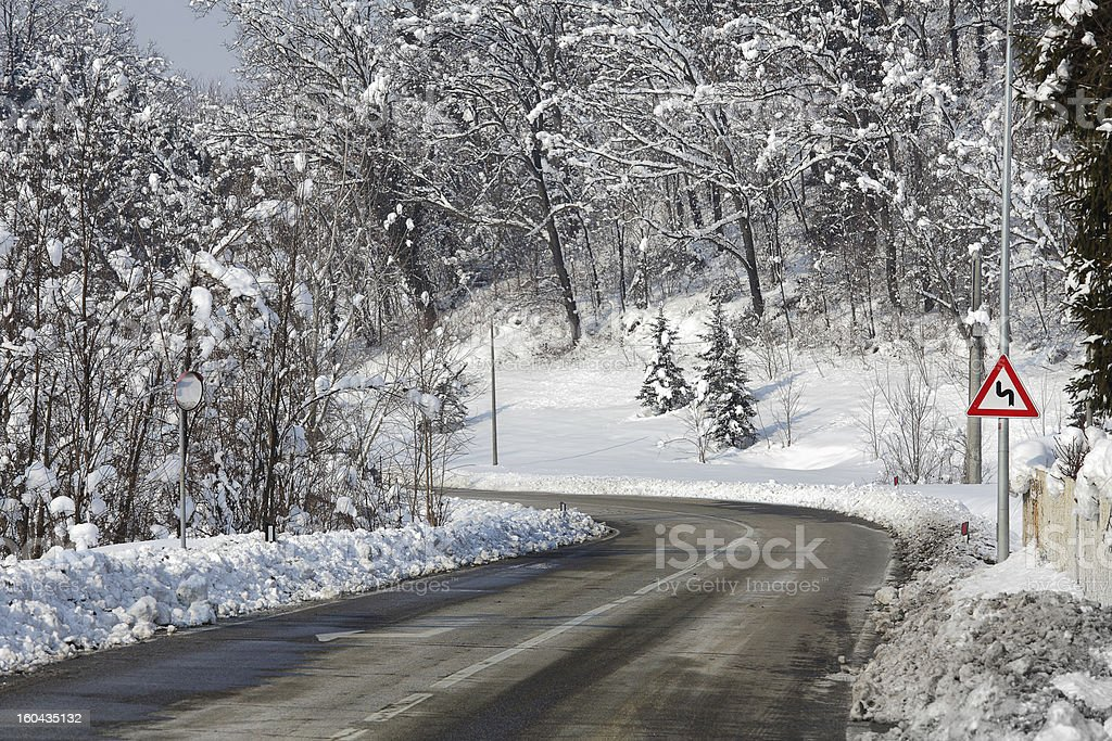 Road through snowy forest. Piedmont, Italy. royalty-free stock photo