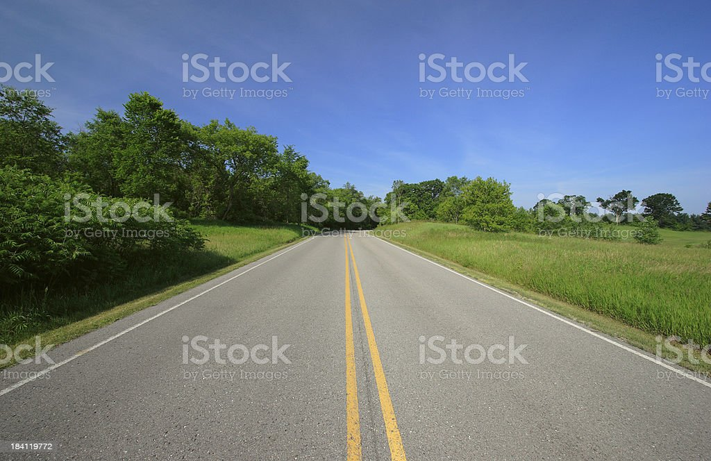 Road Through Sunny Countryside royalty-free stock photo