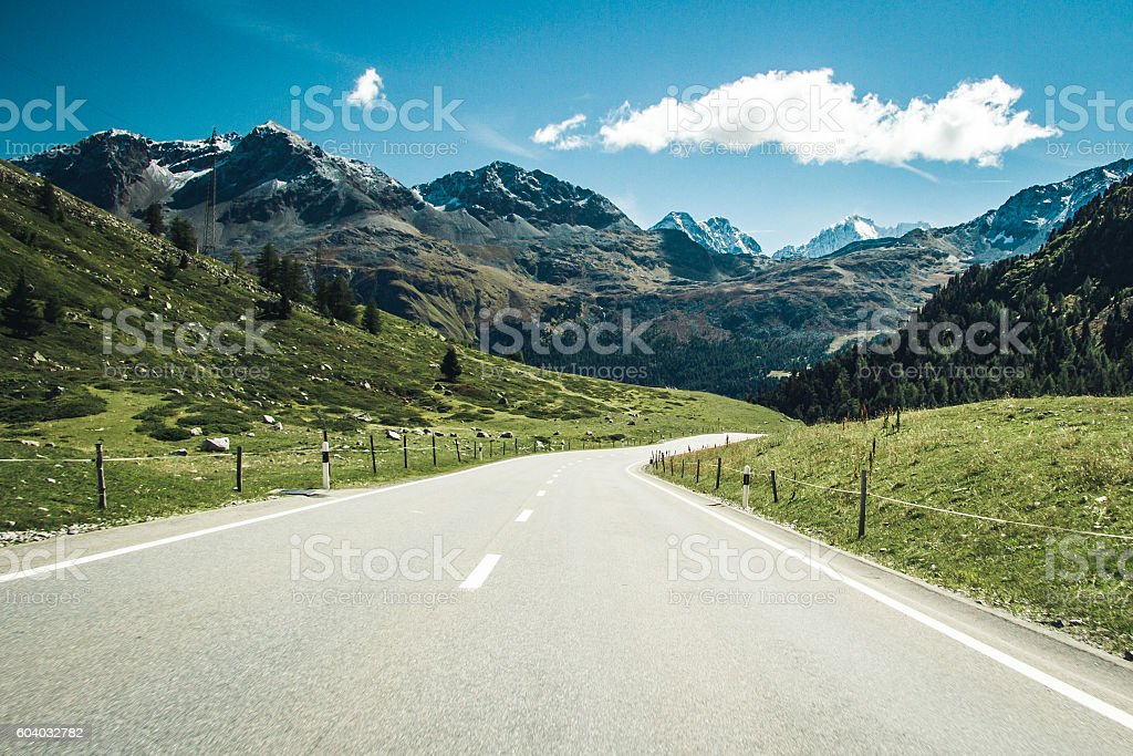 Road through swiss Alps. stock photo