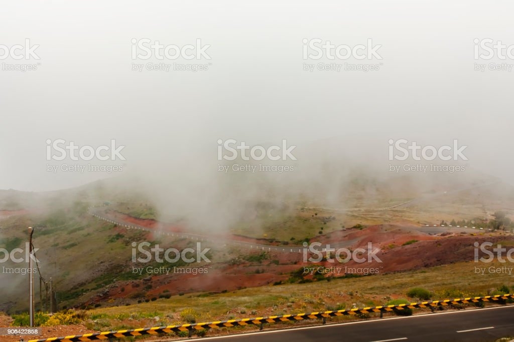 Road through the clouds in the mountains. stock photo