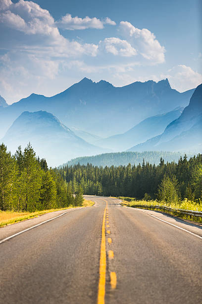 Road through the mountains Highway into nature alberta stock pictures, royalty-free photos & images