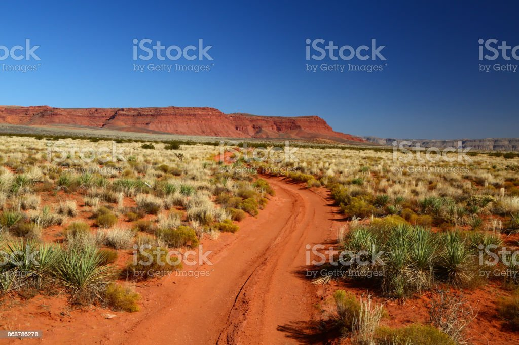 Road through the red dirt of outback stock photo