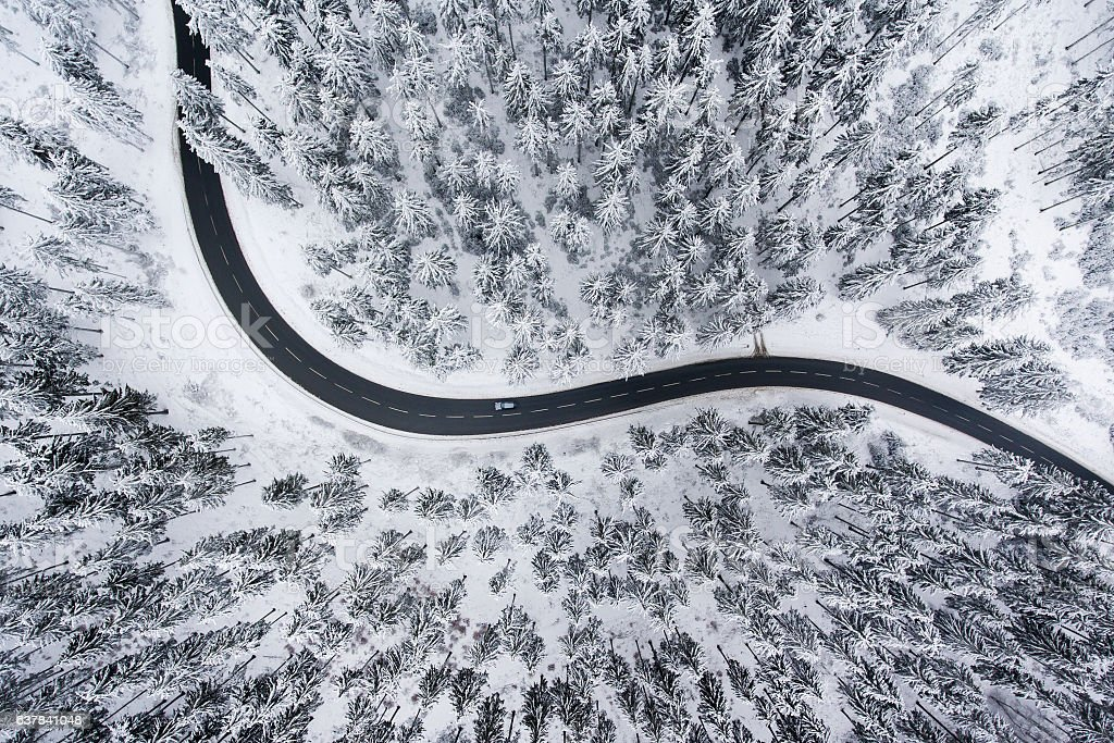 Road through the wintery forest - aerial view - foto de stock