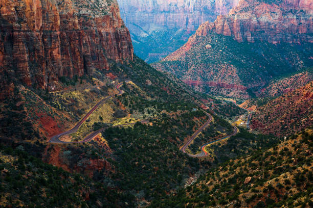 Road through the Zion National Park in Utah Zion Canyon and Mount Carmel Highway seen from Canyon Overlook in Zion National Park, Utah, USA. zion national park stock pictures, royalty-free photos & images