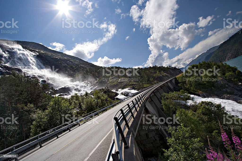 Road through waterfall in the fjords royalty-free stock photo