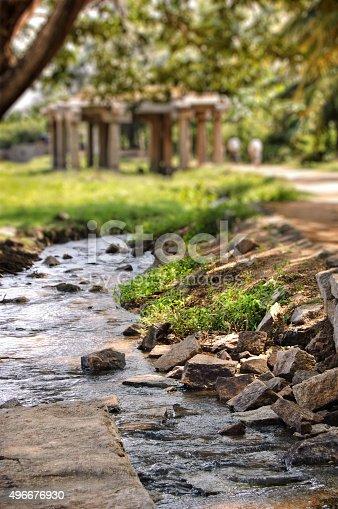 istock Road to a statue of Yoga Narasimha, Hampi, India. 496676930