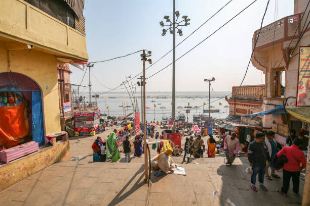 Road to famous Dashashwamedh Ghat at Varanasi India Varanasi, India, January 21,2019: View of street leading to the crowded Dashashwamedh Ganges river ghat at Varanasi India with tourists and pilgrims dashashwamedh ghat stock pictures, royalty-free photos & images