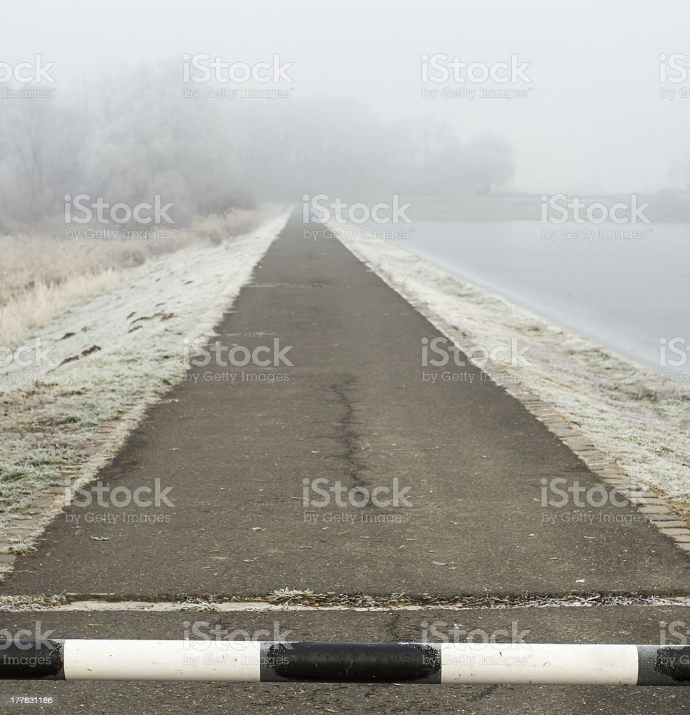 road to far away with barrier on freeze landscape royalty-free stock photo