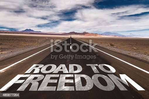 istock Road to Freedom written on desert road 485877054