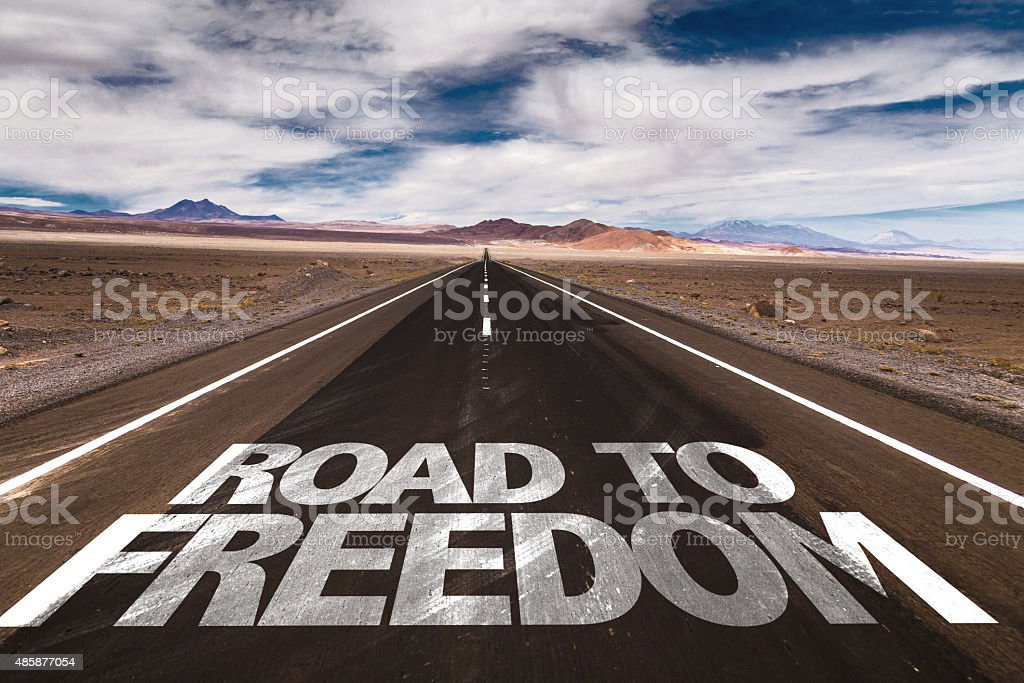 Road to Freedom written on desert road stock photo