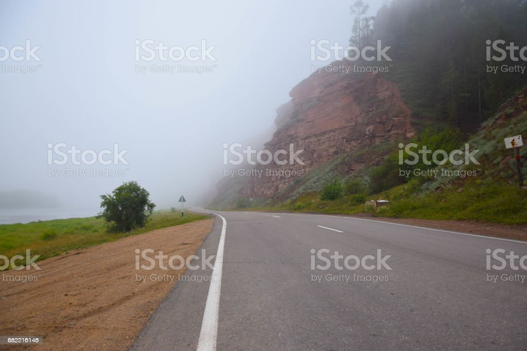 Road to Horizon in Fog. Lonely Way in Siberia. Summer stock photo