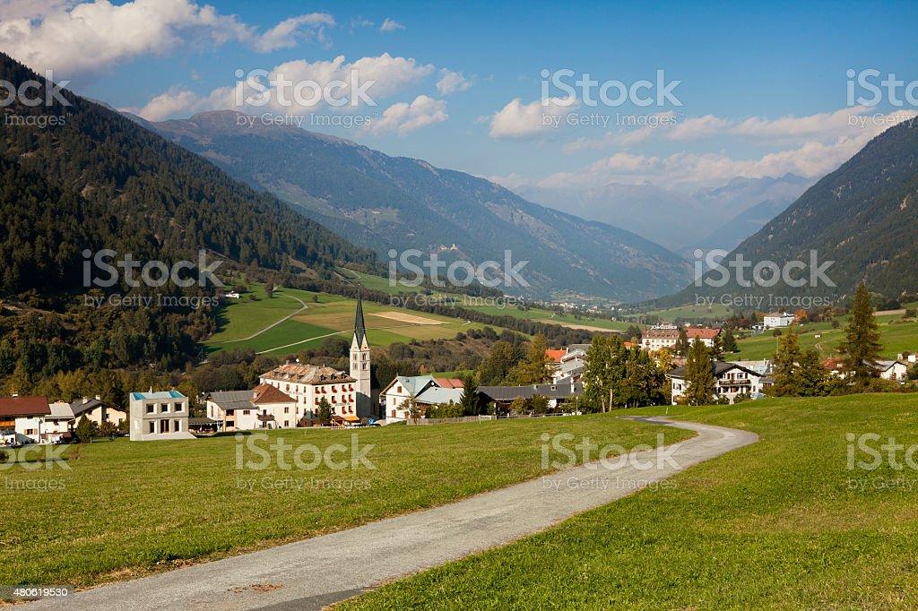 Road to idyllic Swiss mountain village, Val Müstair, Graubünden, Switzerland stock photo