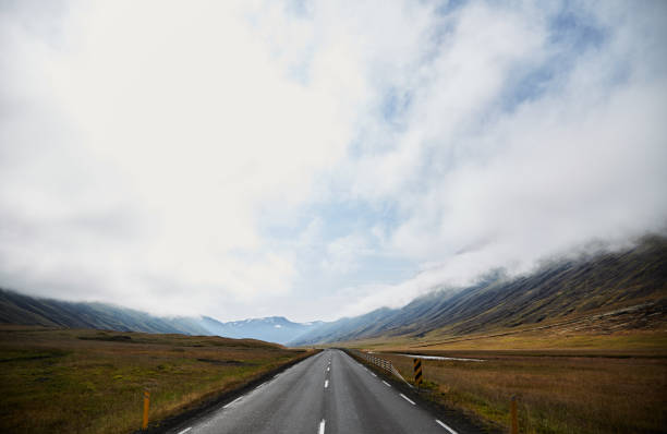 road to infinity in iceland. the road to the horizon - road map stock photos and pictures