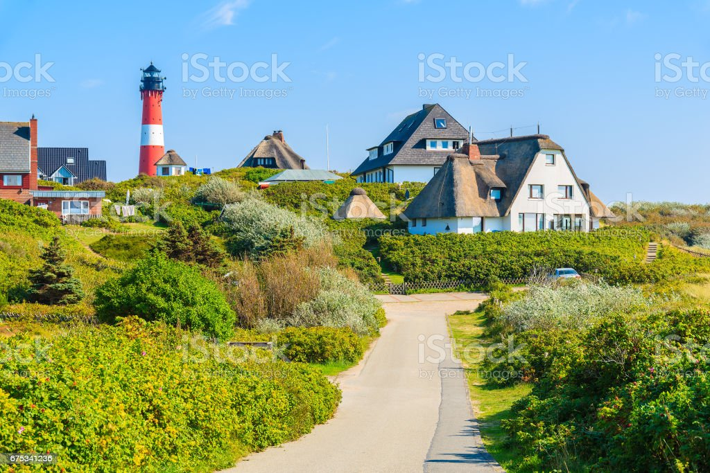 Road to lighthouse in Hornum village on southern coast of Sylt island, Germany stock photo
