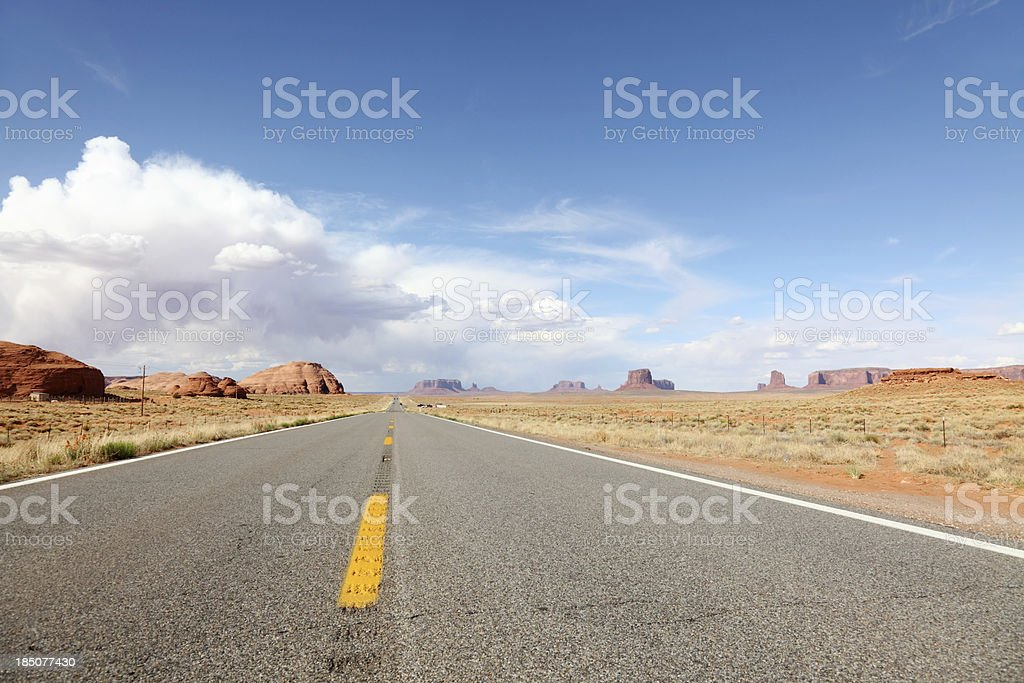 road to Monument valley under cloudy sky royalty-free stock photo