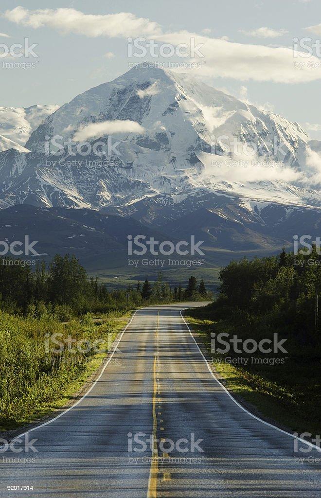Road to mountains stock photo