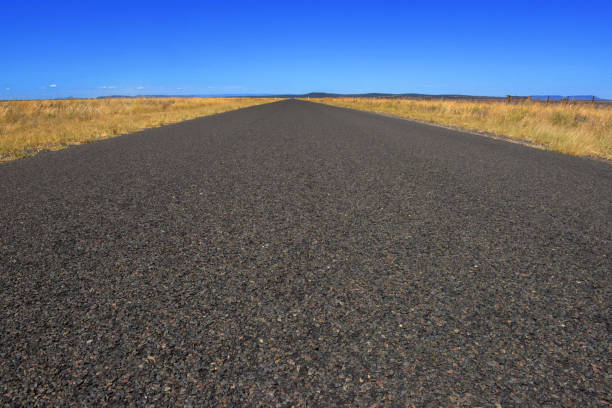 Road to nowhere. An empty road with a blue sky stock photo
