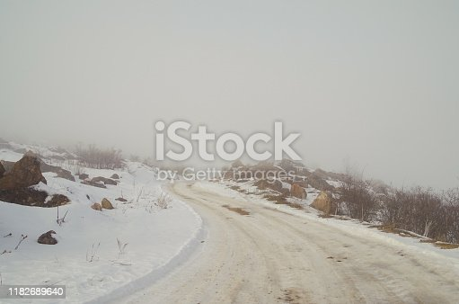 657042754 istock photo Road to nowhere. Fog on mountain ice road. Empty road. Nature and travel. Russia, North Caucasus, southern Dagestan 1182689640