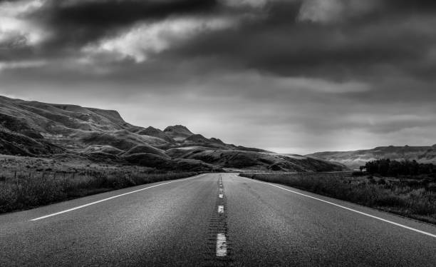 Road to Nowhere Highway through the Badlands of Alberta Canada. monochrome stock pictures, royalty-free photos & images
