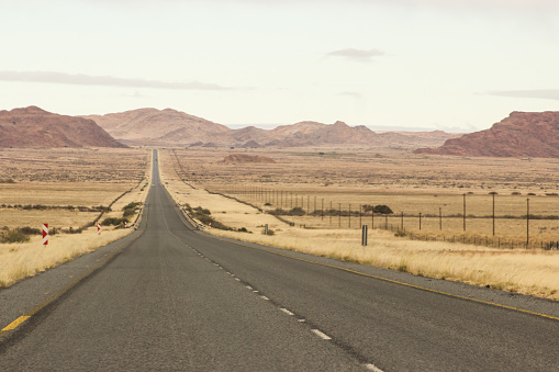 Road cutting straight through the arid region of North-west South Africa, known as Boesmanland