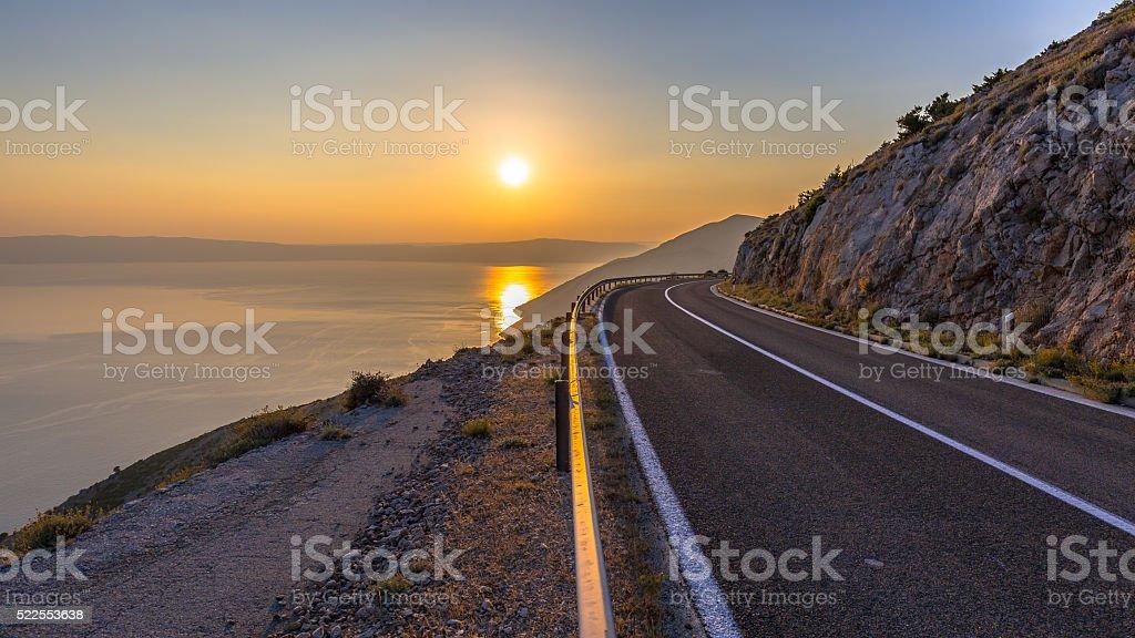 Road to orange sunset stock photo