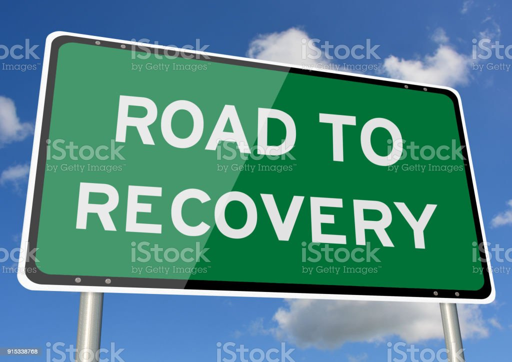 Road to recovery signpost blue sky stock photo