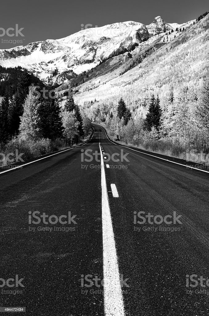 Road to rocky mountains and snow Colorado stock photo