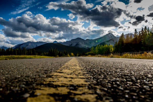road to the mountains walk the center line all the way to the mountains middle of the road stock pictures, royalty-free photos & images