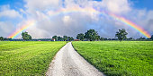 Panorama of Country Road leading towards a Rainbow