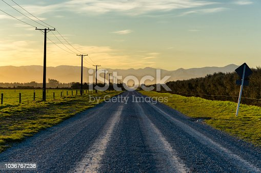 Sunset draws closer on a road running towards the Southern Alps, on New Zealand's South Island.