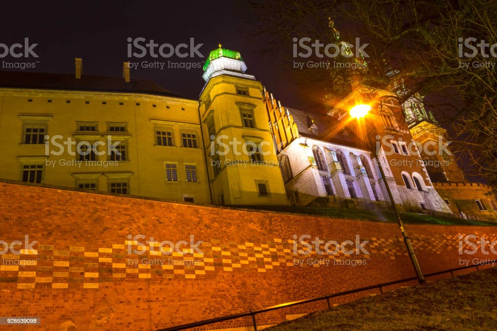 Road to the Wawel Castle, Krakow, Poland. Numerous memorial plaques with names of benefactors stock photo