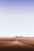 View of beautiful road in the middle of desert with volcano views in Atacama region, Chile
