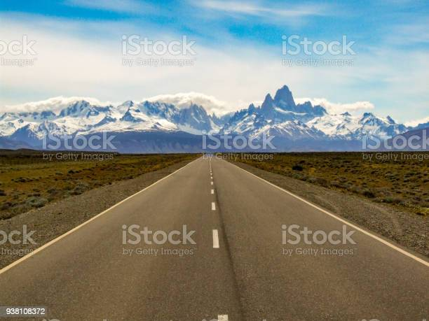 Photo of road towards El Chalten with mountains Fitz Roy and Cerro Torre, patagonia, Argentina