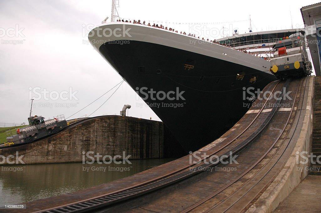 Road tracks along Panama Canal next to large cruise ship stock photo