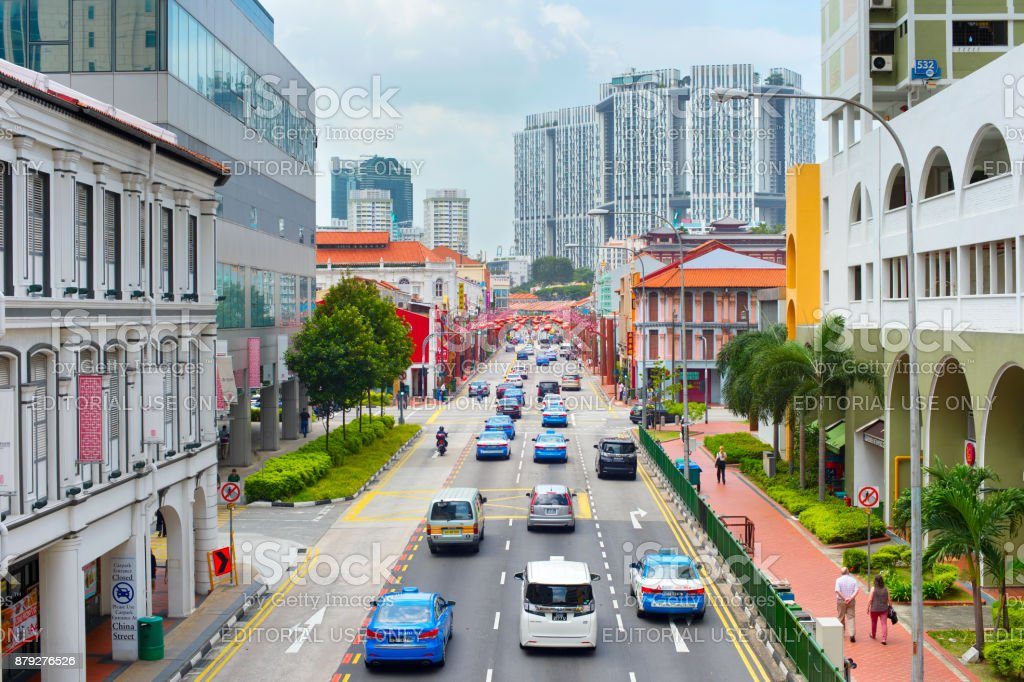 Road traffic in Singapore Chinatown SINGAPORE - FEBRUARY 17, 2017: Traffic on a road in Chinatown of Singapore. SingaporeChinatown is the traditional Chinese quarters of town, the area does retain some of its own charm. Above Stock Photo