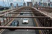 New York, USA - June 21, 2019:  Road traffic over Brooklyn Bridge.