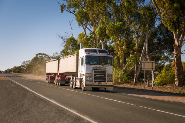 Road Train, Australian truck with trailer in rural countryside through remote town in Victoria stock photo