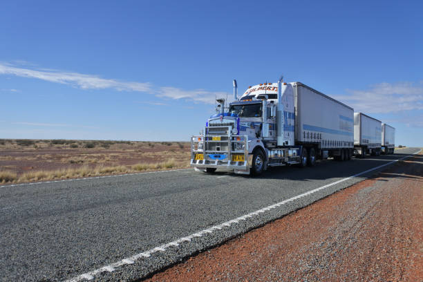 Road train driving in central Australia Outback stock photo