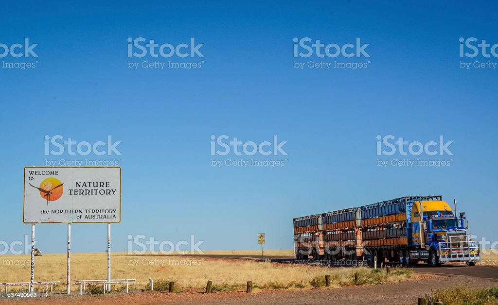 Road Train in Front of Northern Territory Sign, Australia stock photo
