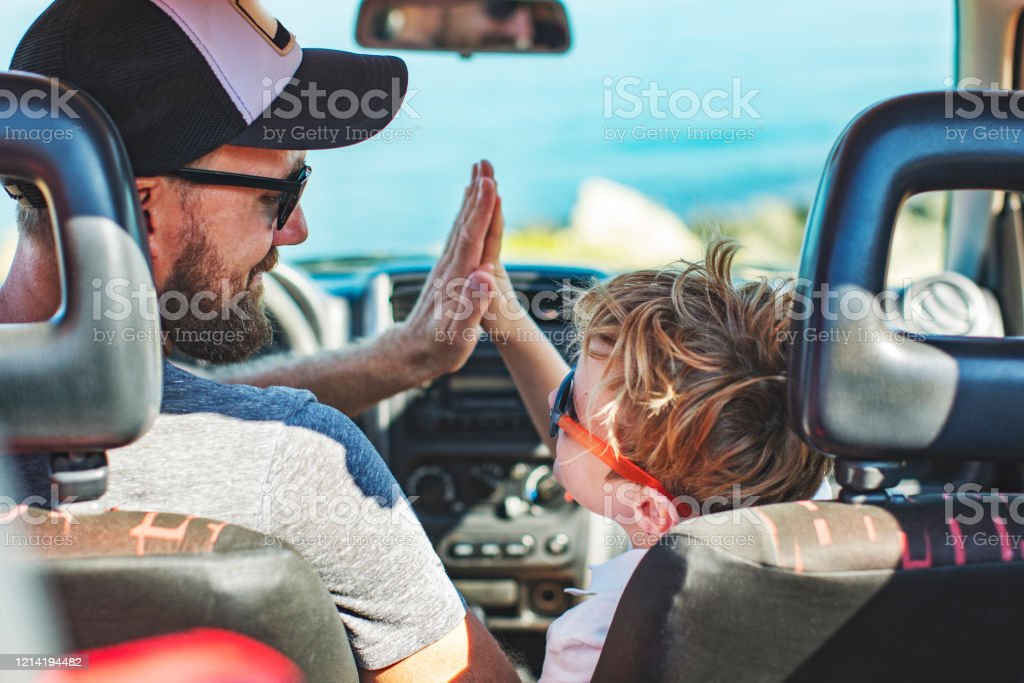 Road trip. Father and son travelling together by car Road trip. Father and son travelling together by car Adult Stock Photo