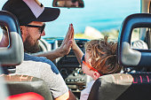Road trip. Father and son travelling together by car