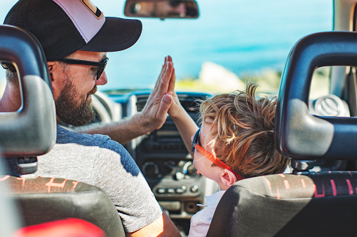 Road Trip Father And Son Travelling Together By Car Stock Photo - Download Image Now
