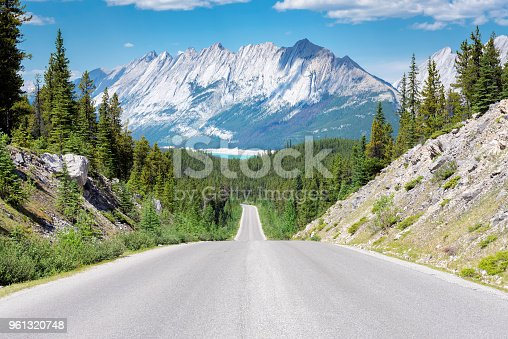 Road Trip in the Rocky Mountains. Beautiful highway in Jasper National park, Alberta, Canada.