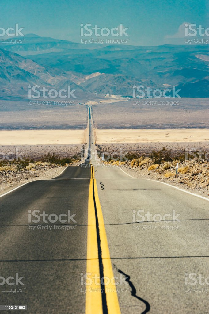 Road trip in USA - road in the middle of the desert inside Death...
